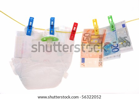 diaper and euro banknotes hanging on clothesline as concept of baby costs