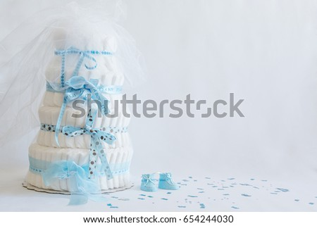 Diaper Cake A multi leveled diaper cake  with blue ribbons and bows for a baby shower. Copy space #654244030