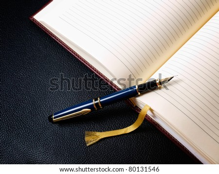 Diary book and fountain pen in retro style