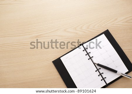 diary notebook with pen