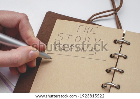 Diary with handwritten text The story begins. Concept of the beginning of a new story. Stockfoto ©