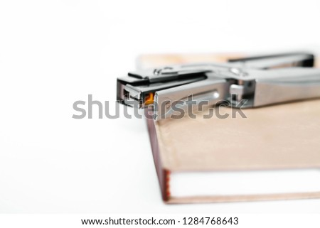 Diary with stapler. Isolated on the white background.