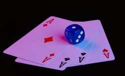 Dice and four aces on a black background with blue-red neon light