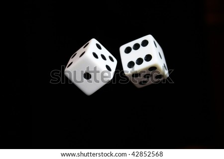 Dice appearing to be thrown in the air