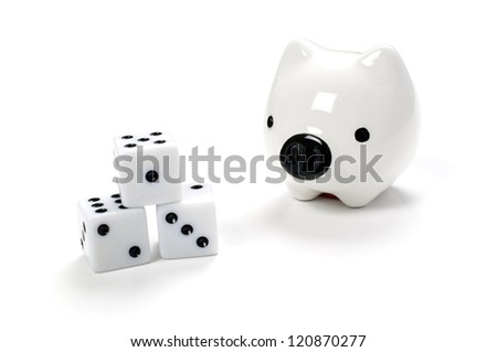 Dice in front of a piggy bank