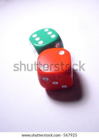 Dice in red and green. Illustrate risk, gamble, chance, fate, any risky behavior or endeavor
