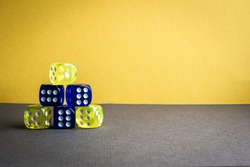 dice of red and blue yellow colors green and black background