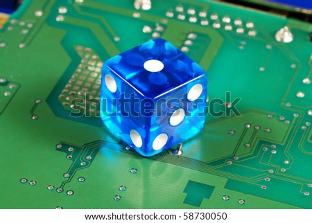 Dice on a computer motherboard concepts of online gambling