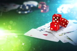Dice on casino gamble table with colorful bokeh lighting effect.
