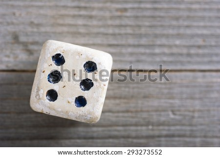 dice on old wood table