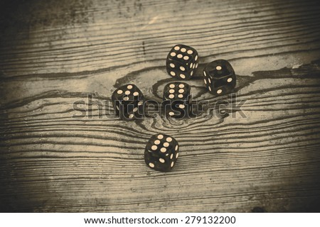dice on the wooden table - triple six, one and five