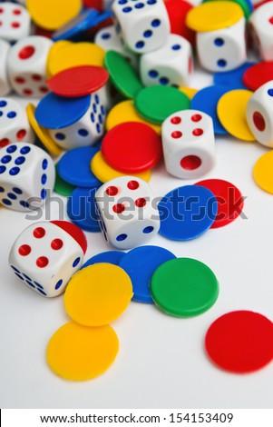 Dice. Plastic dice pile as board game or gambling concept.