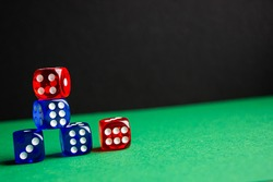 dice red and blue color green and black background