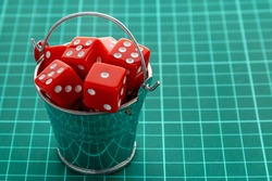 Dice red in a metal bucket. Concept of random numbers.