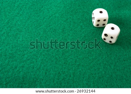 http://image.shutterstock.com/display_pic_with_logo/2031/2031,1237427099,1/stock-photo-dice-rolled-to-snake-eyes-or-double-ones-on-a-green-felt-table-26932144.jpg