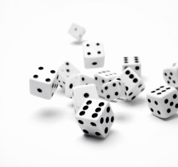 Dice rolling on plain background