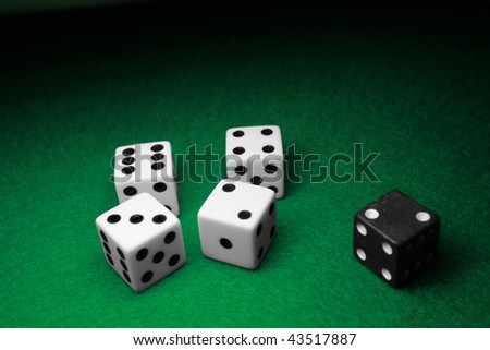 Dice separated over a table of green felt