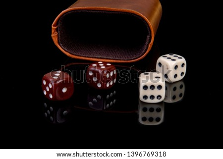 Dice with dice cup on black background #1396769318
