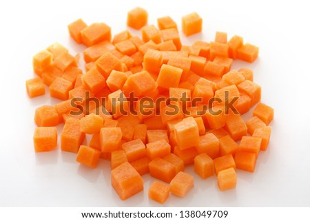 Diced carrots on white - stock photo