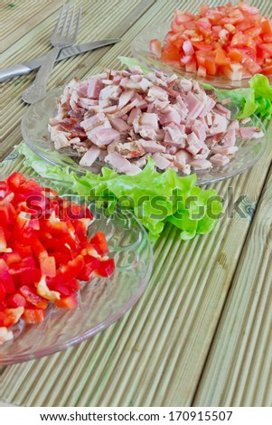 diced ham and vegetables in the dishes on the table