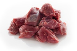 Diced lamb meat on a white background