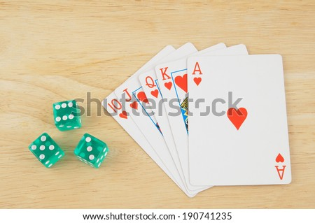 Dices and cards on wooden table
