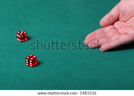 Dices being thrown in a craps game, or any kind of dice involved game, Dices are a clear red color on a green felt table