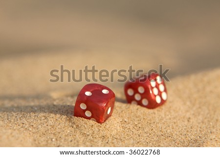 Stock Photo Dices in sand