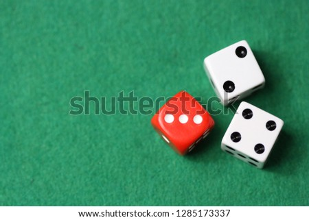 Dices on a green background. #1285173337