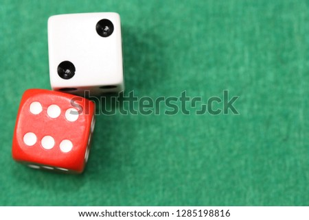 Dices on green background. #1285198816