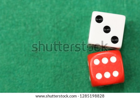 Dices on green background. #1285198828