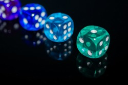 Dices Reflection on Black Background Green Blue Purple Dice