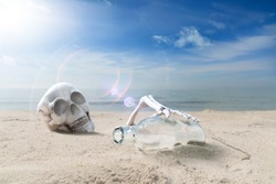 died of thirst person with a bottle on a beach
