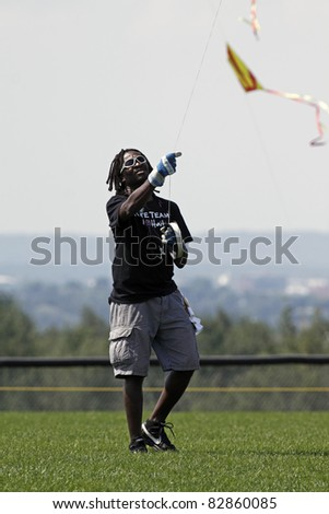 DIEPPE, CANADA - AUGUST 14: Wadson Michel of Haiti steers his kite at the 2011 Dieppe Kite International on August 14, 2011 in Dieppe, Canada.