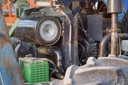 Diesel power engine of tractor, powerful high-tech tractor engine, Repairing a tractor mechanic, engine tractor diesel power 75 horsepower, close up.
