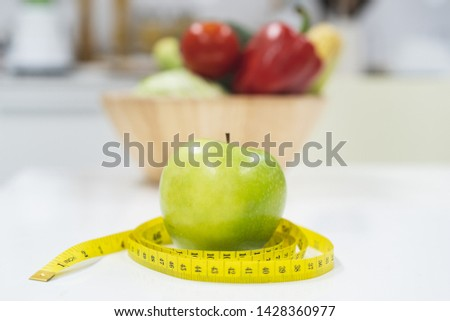 Diet breakfast concept. green apple and measure tape. #1428360977