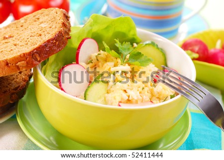 diet breakfast with bowl of  egg and cheese spread