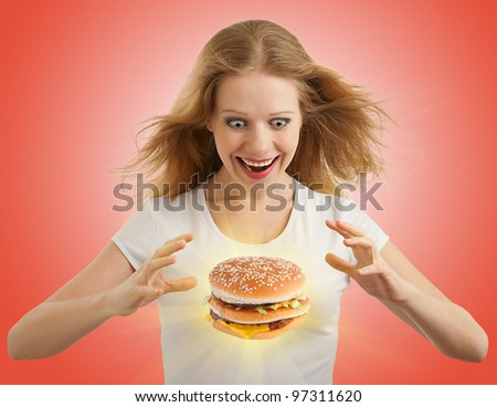 diet concept. Happy girl and a magic flying hamburger on a red background