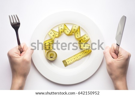 Diet concept, measuring tape, lose weight
