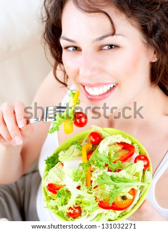 Diet Dieting concept Healthy Food Beautiful Young Woman Eating Vegetable Salad Vegan