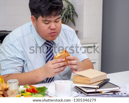 Diet failure of fat man eating fast food unhealthy hamberger. #1305346279