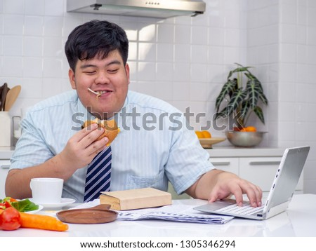 Diet failure of fat man eating fast food unhealthy hamberger. #1305346294