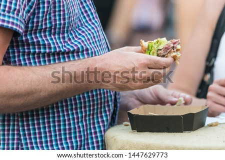 Diet failure of obese man eating fast food unhealthy hamberger. Unhealthy fast food diet as a causes of obesity of population. #1447629773