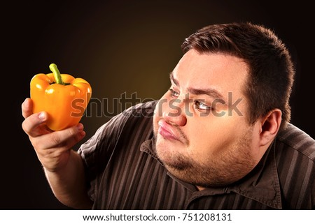 Diet fat man eating healthy food. Health breakfast with vegetables cauliflower and sweet pepper with radish for overweight person. Caricature of fat man. The best diet.