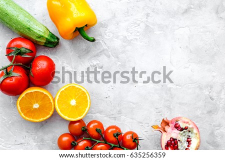 diet food with fresh fruits and vegetables salad stone background top view mockup #635256359
