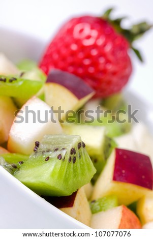 Diet fruit salad in white plate, closeup