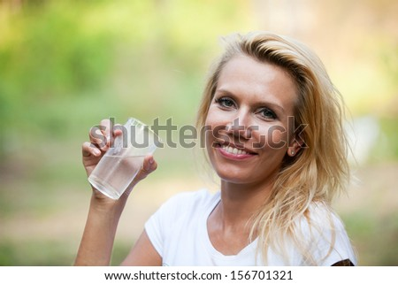 diet, happy smiling woman with glass of water