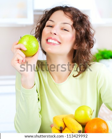 Diet. Happy Young Woman Eating Fresh Fruit. Dieting concept. Healthy Food. Vegan Food