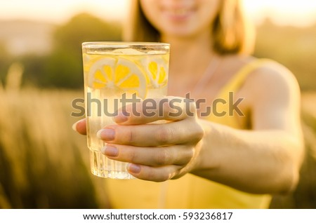 Diet. Healthy eating .Woman hand holding lemonade drink  on the background blurred nature outdoor. Fresh detox vegetable juice. Healthy lifestyle, vegetarian food. Nutrition Concept.