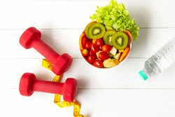 Diet Healthy food and lifestyle health concept. Sport exercise equipment workoutandgym background with nutrition detox salad for fitness style. Health care Concept